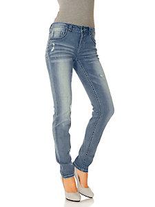 Jean slim extensible et délavé, coutures contrastantes